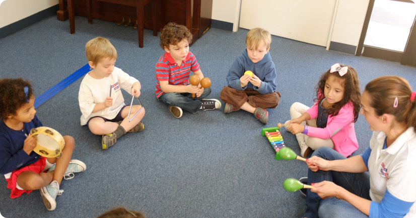 group of toddlers playing instrument