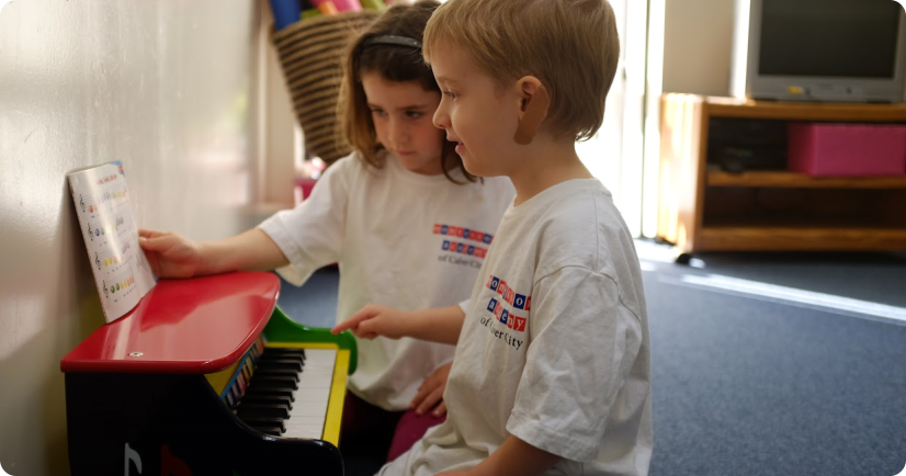 two kids playing piano